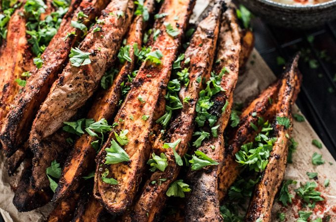 These easy to make Sweet and Spicy Yam Wedges are covered in smoked paprika and chili spices then baked till tender and delicious. They're simple side dish recipe everyone will love. | theendlessmeal.com