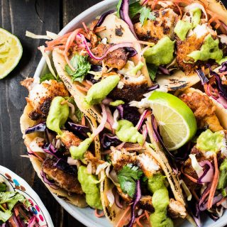These crazy delicious Baja Fish Tacos are made with white fish coated in blackening spice rub then pan-seared till tender. They're served with a crunchy and easy to make coleslaw and aji guacamole, my all-time favorite taco sauce. They're a healthy dinner recipe that is gluten-free and (if served with lettuce wraps rather than tortillas) paleo + Whole30 approved, too. Dig in!   theendlessmeal.com