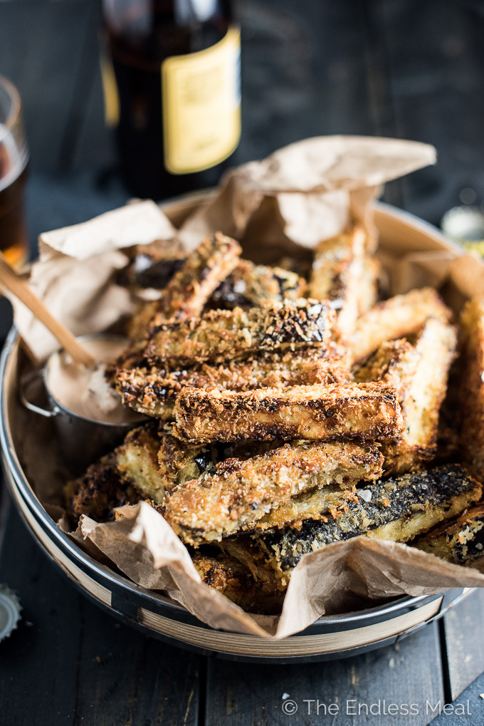 These easy to make Crispy Eggplant Fries are insanely delicious. They are coated in panko and parmesan and oven baked till crisp. They're perfect as a simple, family-friendly side dish recipe or game day appetizer. You'd NEVER guess that they are made with eggplants! | theendlessmeal.com