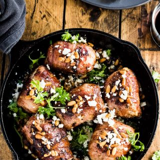 This Mediterranean Chicken is stuffed with feta cheese, sun-dried tomato pesto, and black olives, wrapped in salty bacon and pan fried till crispy. It's a surprising simple to make and totally delicious dinner recipe that is fancy enough for a dinner party yet easy enough to make for a weeknight meal. | theendlessmeal.com