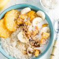 Tropical Summer Coconut Oatmeal is a quick, healthy, and delicious vegan + gluten free breakfast. You will LOVE how light and summery this porridge is! | theendlessmeal.com