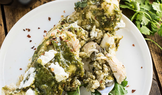 These delicious Green Chicken Enchiladas are stuffed with arroz verde (tasty green rice) and smothered in a spicy charred tomatillo sauce. It's an easy to make and healthy casserole recipe that makes a tasty weeknight dinner. Ringing in at only 250 calories per serving means you can go back for seconds or even thirds!   theendlessmeal.com
