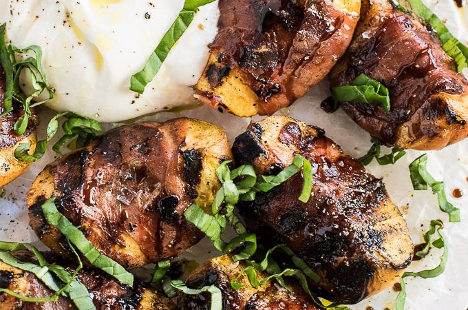Sweet Grilled Peaches wrapped in salty prosciutto that turns crispy on the BBQ are an easy and delicious summer appetizer or starter. They're great in a salad, served beside some creamy burrata or on their own. | theendlessmeal.com