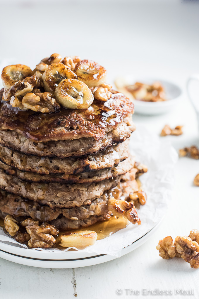 These delicious Banana Walnut Protein Pancakes are our go to Sunday morning breakfast. They're packed full of protein (but no protein powder!) and are made without any refined sugar or grains. You will LOVE them! | theendlessmeal.com
