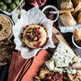 Creating a killer cheese board is all about having lots of variety. Having a hot out of the oven element is perfect for the holiday season. Try this melty cranberry baked brie with pistachios and honey. Yum! | theendlessmeal.com