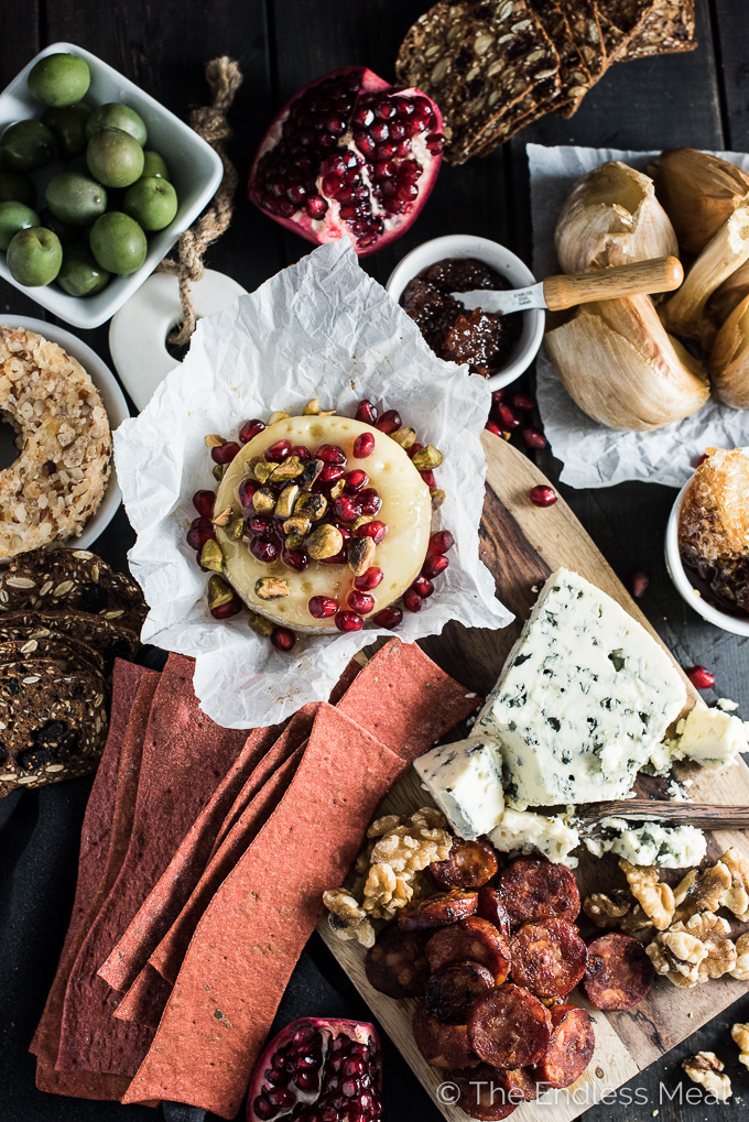 Creating a killer cheese board is all about having lots of variety. Having a hot out of the oven element is perfect for the holiday season. Try this melty pomegranate baked brie with pistachios and honey. Yum! | theendlessmeal.com