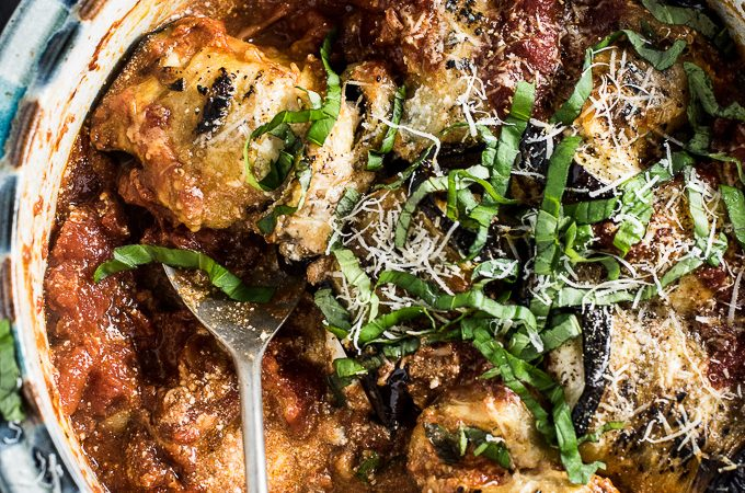 This Easy Eggplant Involtini recipe is a breeze to make yet keeps all of the original delicious flavors. The eggplant is baked then rolled around creamy ricotta and simmered in a basic tomato sauce. Serve it with a side of garlic bread and a Caesar salad for a simple main course meal. | theendlessmeal.com