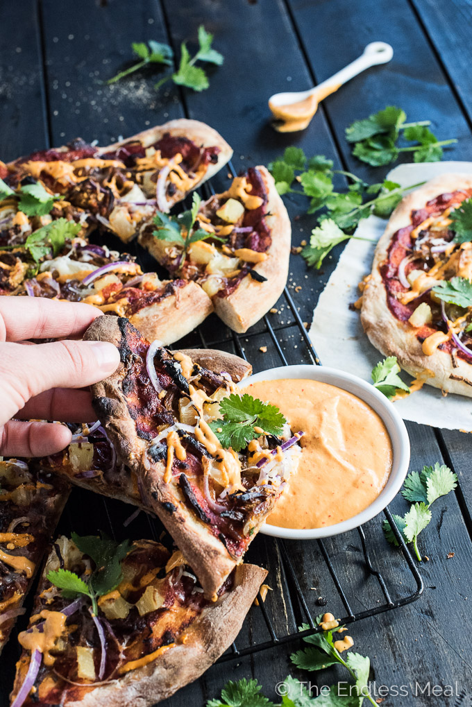 Gochujang Pulled Pork Korean Pizza is a remake of the classic ham and pineapple pizza and WAY BETTER than the original. It's served with an easy to make kimchi dipping sauce and is crazy delicious. | theendlessmeal.com