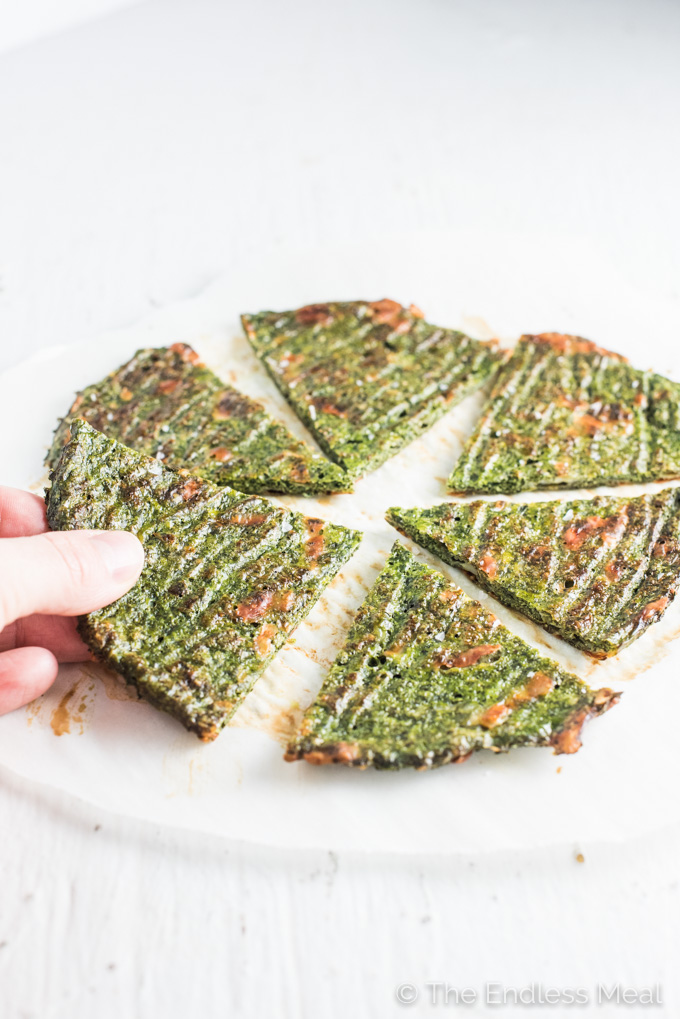 Did you know you can make a Veggie Pizza Crust without any flour and it still tastes AMAZING! Make this low-carb green pizza crust with either kale, spinach, broccoli, or zucchini and sneak some extra veggies into your meal. It's a surprisingly delicious dinner recipe! | theendlessmeal.com