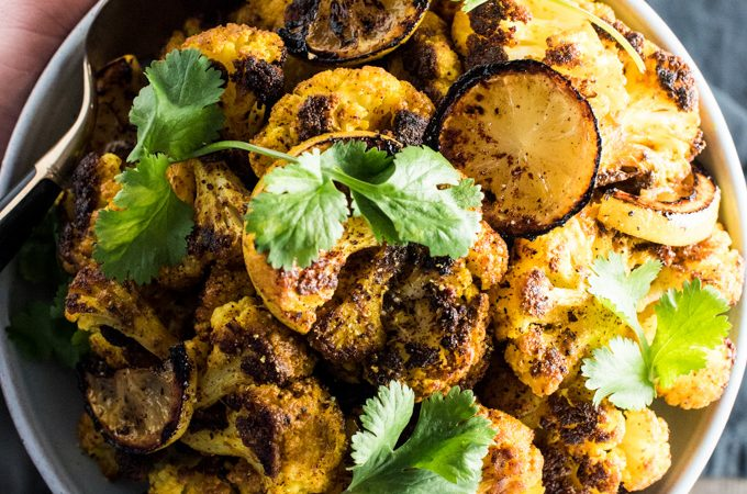 Golden Roasted Turmeric Cauliflower is a super simple side dish recipe that is as healthy as it is delicious. It is a naturally vegan + paleo + low carb recipe to add to your clean eating recipe list. You will LOVE it! | theendlessmeal.com