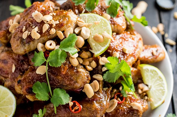 These insanely delicious Thai Peanut Chicken Wings are oven baked until super crispy and then coated in an easy to make sweet and spicy Thai peanut sauce. They're the perfect appetizer recipe for any game day party! | theendlessmeal.com