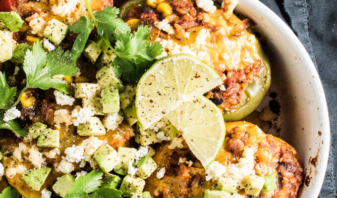 These delicious Vegetarian Enchilada Stuffed Peppers are made with brown rice, corn, and beans smothered in enchilada sauce and stuffed into colorful bell peppers. They are an easy to make and healthy dinner recipe that is naturally gluten-free and can easily be made vegan.   theendlessmeal.com