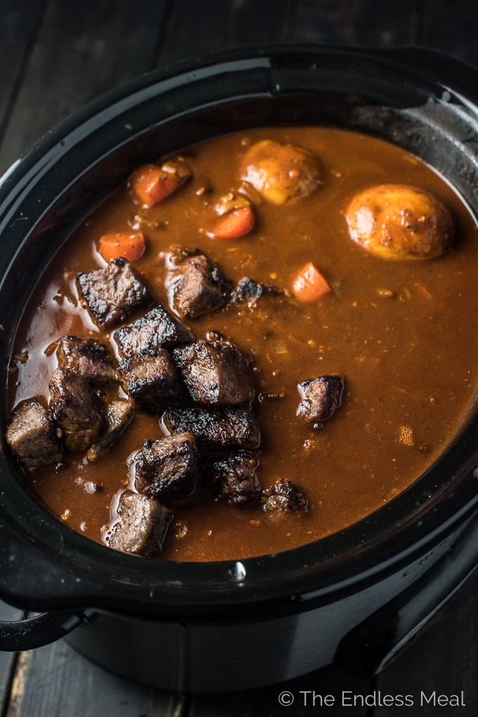 Just in time for St. Patrick's Day, but perfect for any day, is this Guinness Crock Pot Beef Stew recipe. I've snuck a little chocolate in here, too. I know it sounds strange, but you don't actually taste the chocolate; it simply adds a little richness to the stew. You will LOVE it! | theendlessmeal.com