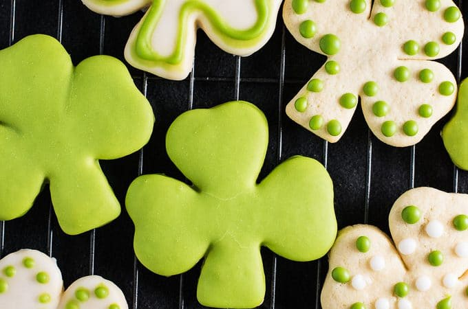 These Shamrock Sugar Cookies are made with my all-time favorite soft sugar cookie recipe. The frosting is tinted bright green with an easy to make all-natural food dye. There's no creepy artificial color in these cookies! Happy St. Patty's Day! 💚 | theendlessmeal.com