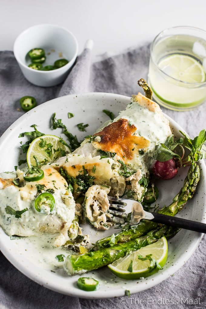 These Spring Veggie Enchiladas are stuffed with loads of healthy spring vegetables, your choice of tofu or chicken, and then smothered in an easy to make creamy yogurt sauce. They are a ridiculously delicious dinner recipe.   theendlessmeal.com