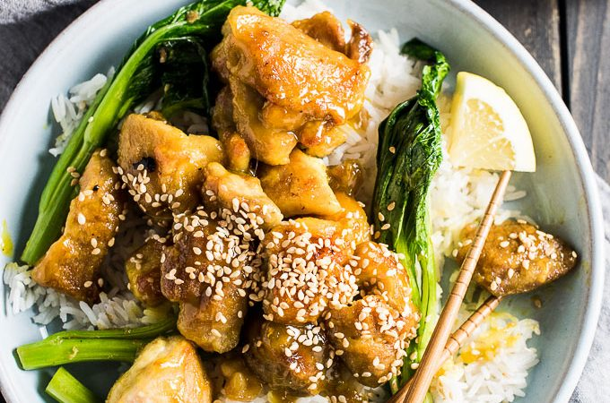 This delicious Lemon Sesame Chicken is easy to make and better than any take-out Chinese meal. The chicken is pan fried in coconut oil and coated in a lemony sesame sauce. It's a healthy and naturally gluten-free dinner recipe you will fall in LOVE with! | theendlessmeal.com