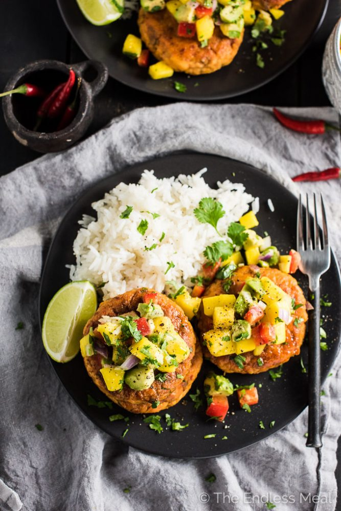 These delicious Thai Fish Cakes are bursting with flavor. The salmon is cooked in coconut milk and Thai spices then cooled and formed into patties. A quick sear in coconut oil makes the edges crispy and leaves the inside super tender. Top them with the fruit salsa for a simple yet totally tasty dinner recipe that is naturally paleo + gluten-free.   theendlessmeal.com