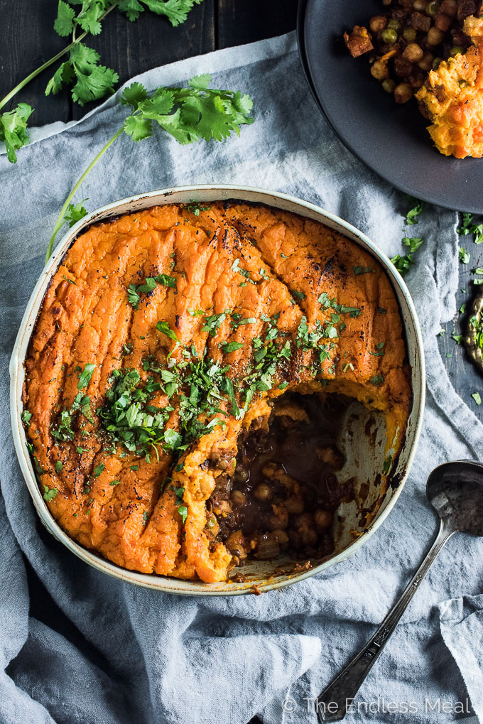 Vegan Shepherd's Pie has tons of flavor thanks to curry spices and caramelized tomato paste. It's loaded with veggies, lentils, and chickpeas and topped with coconut mashed sweet potatoes. Whether you're looking for a vegan Easter dinner recipe or a healthy, family-friendly meal, this is casserole is as delicious as it gets!   theendlessmeal.com