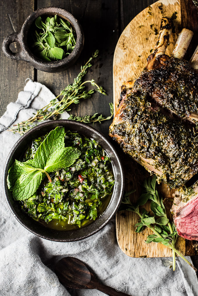 This easy to make Herb Roasted Rack of Lamb is served with a side of mint chimichurri and is crazy delicious. Whether you're looking for simple weekend dinner or an impressive Easter main course, this is it. It's also naturally gluten-free + paleo + Whole30 approved. Dig in! | theendlessmeal.com