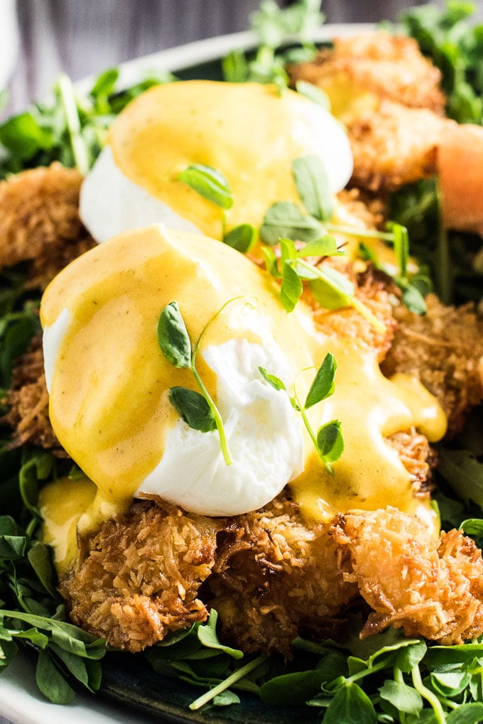I'm fairly certain that Thai Coconut Shrimp Eggs Benedict is the only eggs benny I'll ever eat again. Perfectly poached eggs sit on top of crispy baked coconut shrimp and are smothered in a lightly flavored Thai curry hollandaise sauce. This insanely delicious breakfast recipe also happens to be healthy for you. (Crazy, I know!) It's naturally gluten-free + paleo + Whole30 compliant. You will LOVE it! | theendlessmeal.com